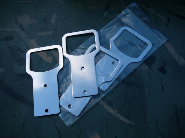 A close-up of the stainless steel garment hook mounting brackets.