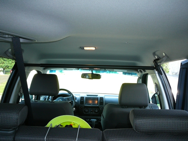 A view of the front support bar attached to the grab handles looking from the rear of the Xterra.