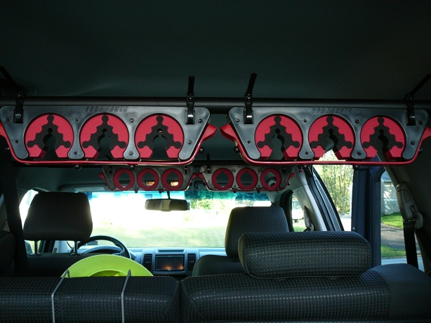 The rod holders are attached to the support bars by threading the reusable zip tie through the slot on the holder, and then around the bar. Pictured above, the front rod tip holders and rear butt holders in the typical setup.