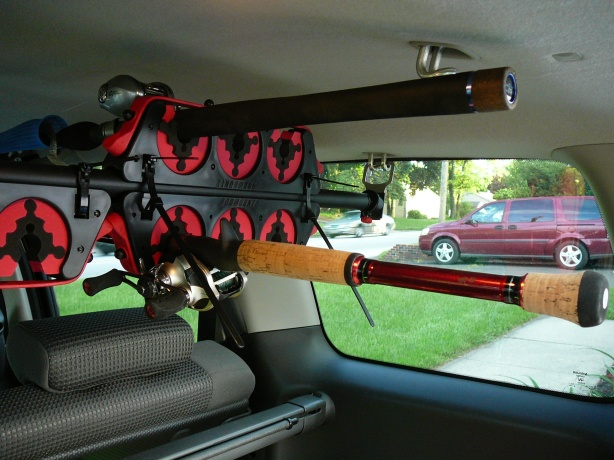 "The rear rod holders with two rods; on top was a Full Grip 7'8"" Dobyns DX784C Mike Long Edition Swimbait Rod. Below is a Split Grip Powell Max/Tackle Warehouse 8' 806CF Punch Rod."